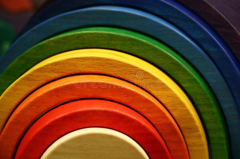Wooden rainbow. The wooden toy rainbow consists of eight original parts stock images