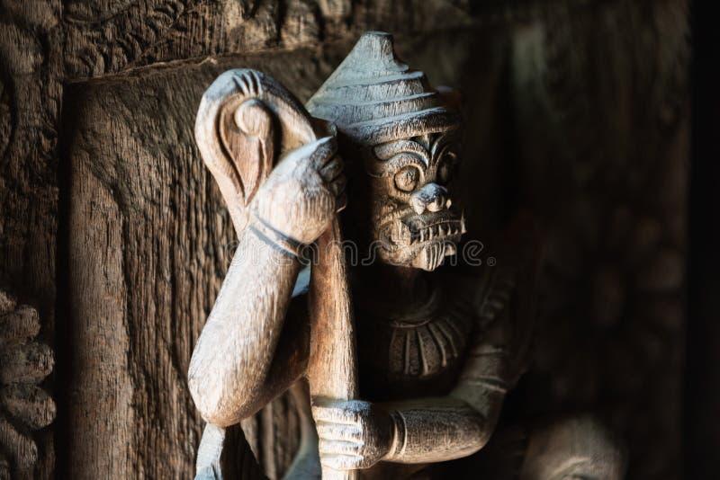Wooden Ramayana guardian on the gates of Shwe In Bin Kyaung monastery in Mandalay, Myanmar. Wooden Ramayana guardian statue on the gates of teak Shwe In Bin stock images