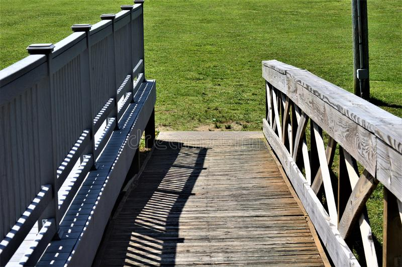 Wooden Ramp Leading Downward to a Grassy Field royalty free stock photo