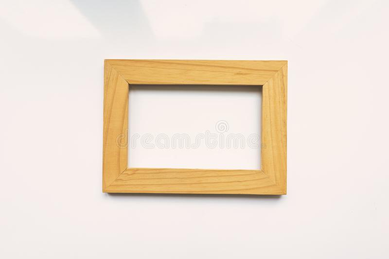 Wooden rectangular photo frame on white background. Close-up. Top view. Nobody, empty. Wooden rectangular photo frame on white background vector illustration