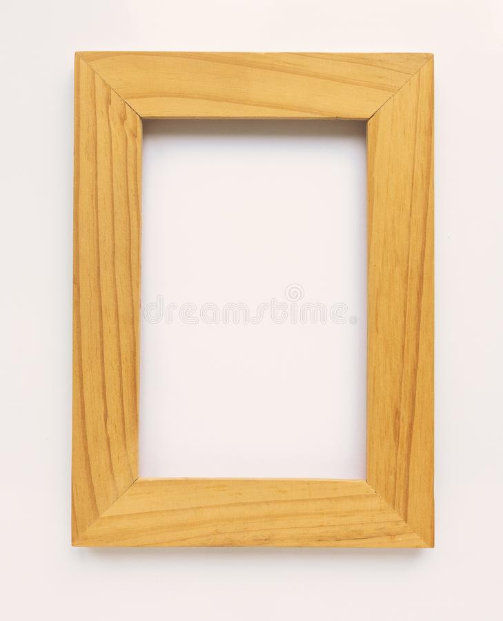 Wooden rectangular photo frame on white background. Close-up. Top view. Nobody, empty stock illustration