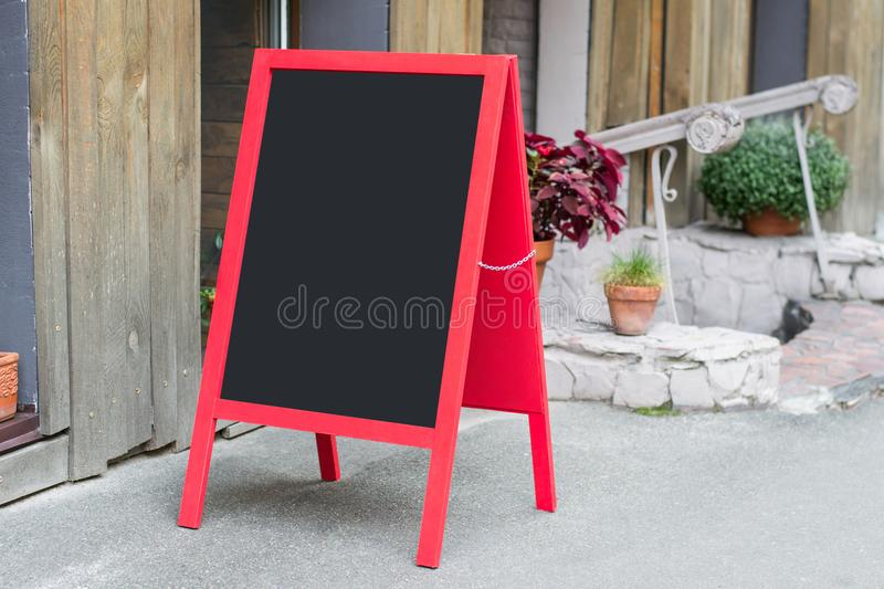 Wooden red restaurant signboard with place for text on the street ad advert advertising food menu poster bigboard placard empty bl royalty free stock images