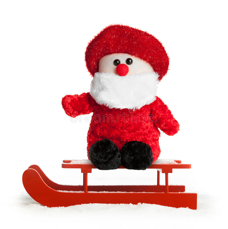 Wooden red sled with Santa Claus plush stock photography