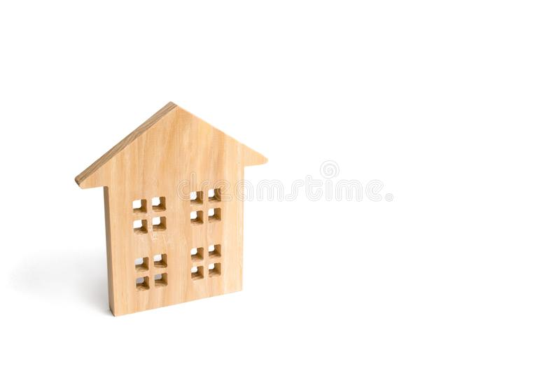 Wooden residential house on a white background. Isolate Real estate concept, buying affordable housing, selling real estate. And renting. Property tax. Mortgage royalty free stock photo
