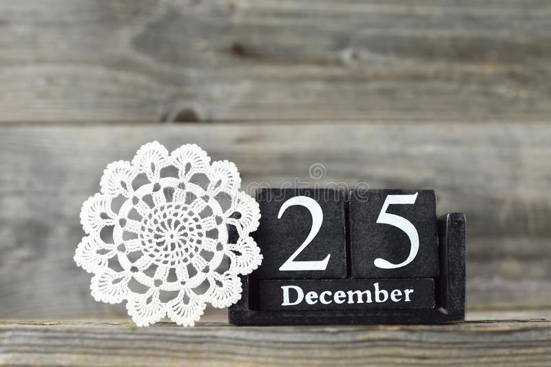 Retro calendar with the date of Christmas and lace doily royalty free stock images