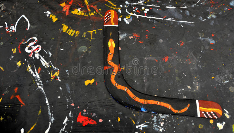 Wooden returning boomerang. Indigenous Australian art Dot painting on returning boomerang. It's one of the oldest traditional form of art in the world. Paint royalty free stock image