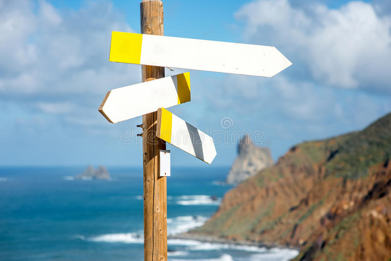 Wooden road sign with empty boards stock photos