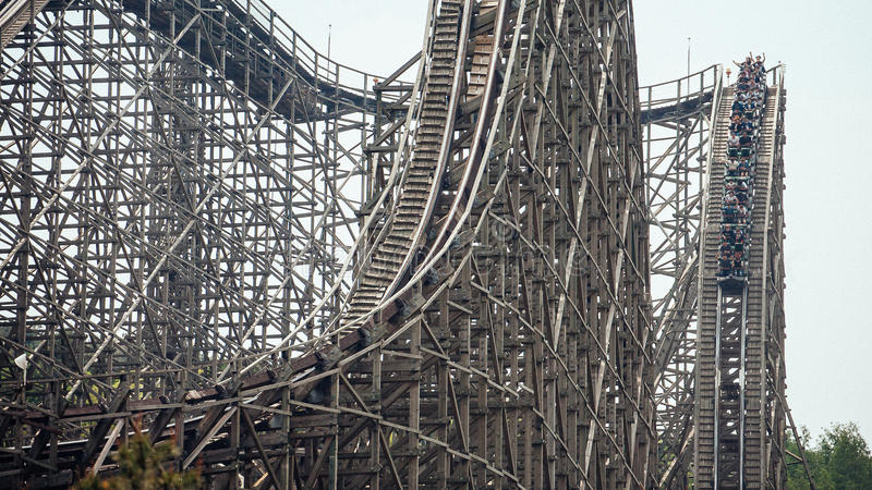 Wooden roller coaster with a steep drop stock image