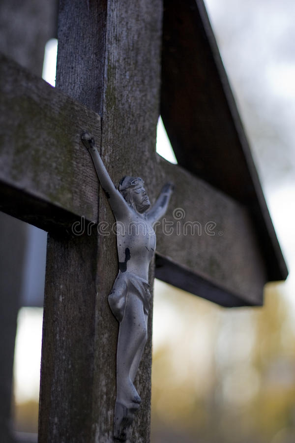 Wooden rood. Old wooden rood on the cemetery stock images
