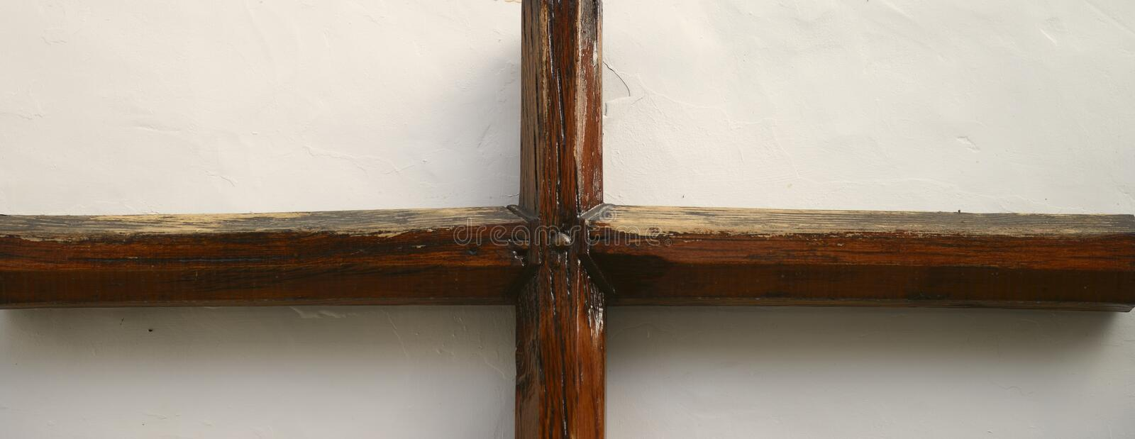 Wooden rood. In wall stone royalty free stock photography