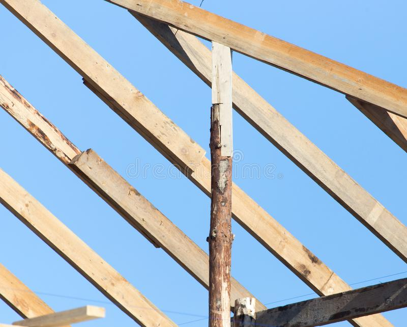 Wooden roof frame on a construction site stock photography