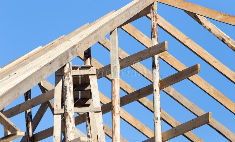 Wooden roof frame on a construction site royalty free stock images
