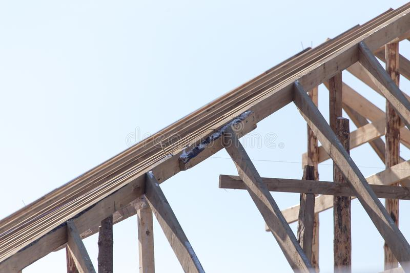 Wooden roof frame on a construction site royalty free stock photos