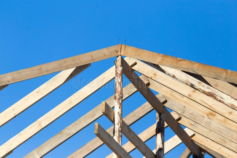 Wooden roof frame on a construction site stock photo