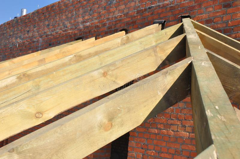 Wooden Roof Frame House Construction with Wooden Beams, Rafters, Trusses, Timber. Photo stock photography