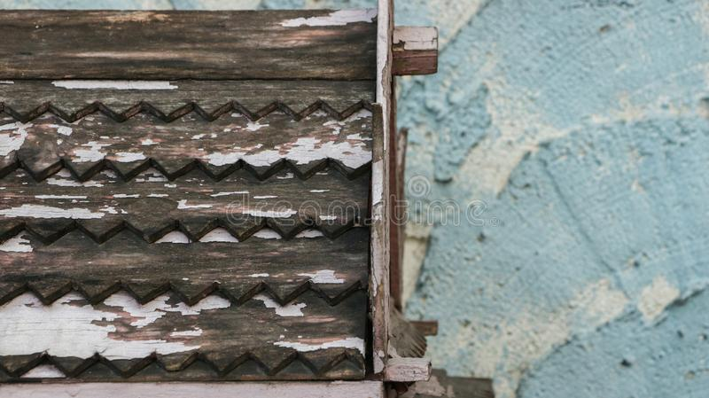 Wooden Roof Pattern with Peeling White Paint on Rough Painted Te stock photo