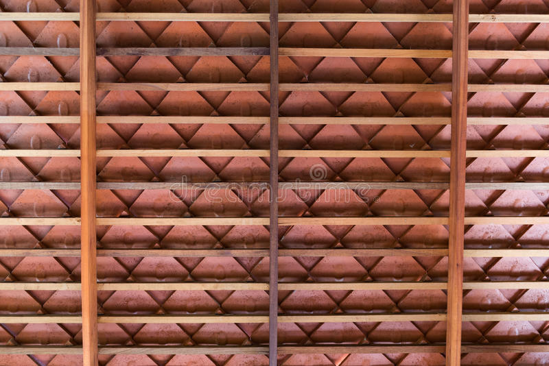 Wooden roof structure with terracotta roof tiles stock photos