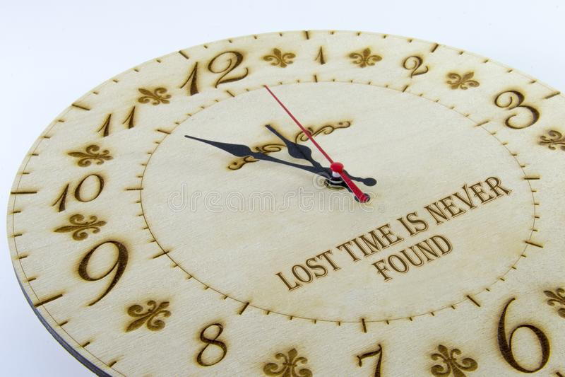Wooden round wall watch - clock isolated on white background. Manage your time.  stock photo