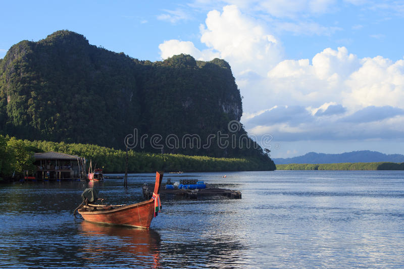Wooden rowing boat on blue sea water and sun light reflect. Nature landscape at Trang Thailand royalty free stock photos