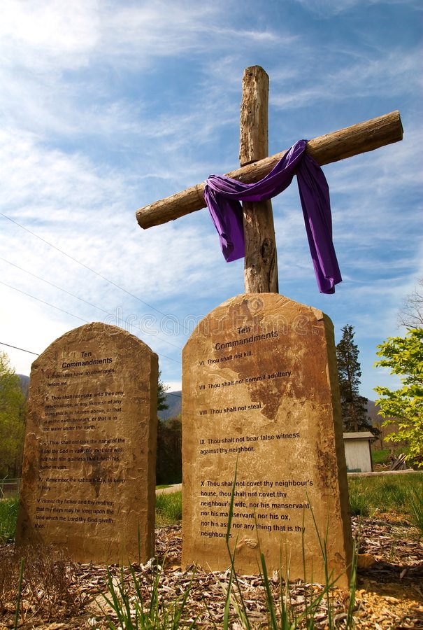 Wooden rugged cross with ten commandments stock photos