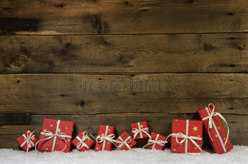 Wooden rustic background with red christmas presents. stock images