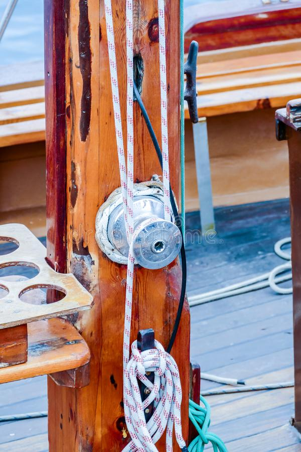 Wooden sailboat on the blue mediterranean sea Details of a classic beautiful sailing yacht with ropes knots and wood plank on deck. Wooden sailboat on the blue royalty free stock photos