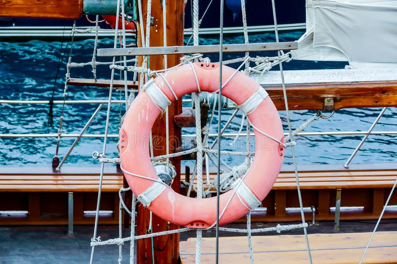 Wooden sailboat on the blue mediterranean sea Details of a classic beautiful sailing yacht with ropes knots and wood plank on deck. Wooden sailboat on the blue stock images