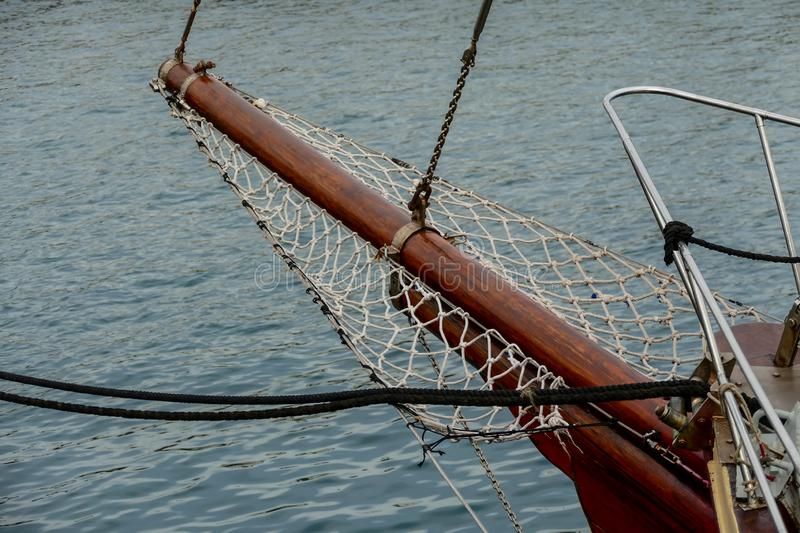 Wooden sailboat on the blue mediterranean sea Details of a classic beautiful sailing yacht with ropes knots and wood plank on deck. Wooden sailboat on the blue stock photography