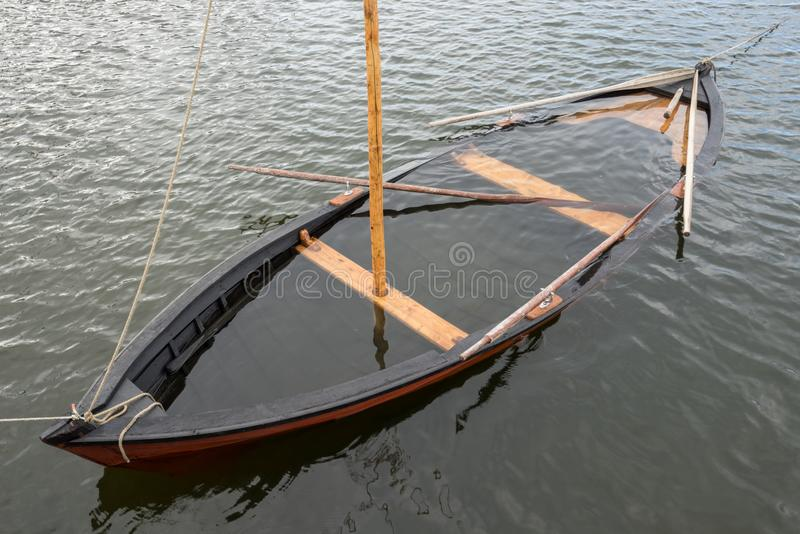 Wooden sailboat on the sea stock photography