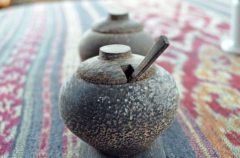 Wooden salt shaker. Wooden pepper shaker. royalty free stock images