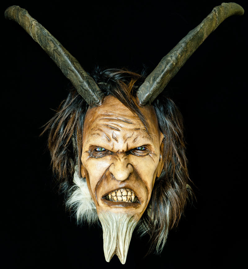 Wooden satan evil mask royalty free stock photos
