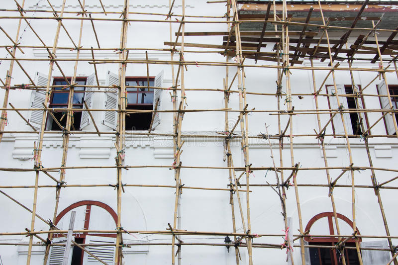 Wooden scaffolding around new building in Thailand royalty free stock photos