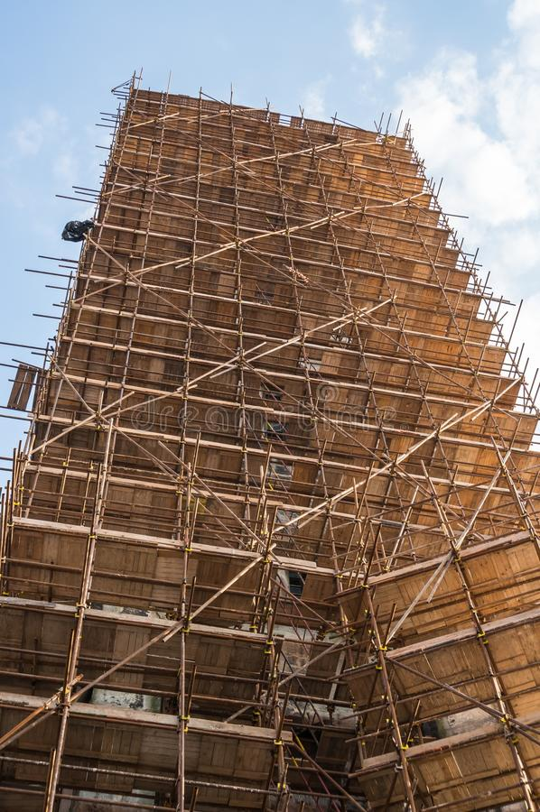 Wooden scaffolding around old building stock images