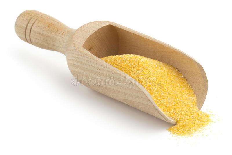 Wooden scoop with cornmeal. On white background stock images