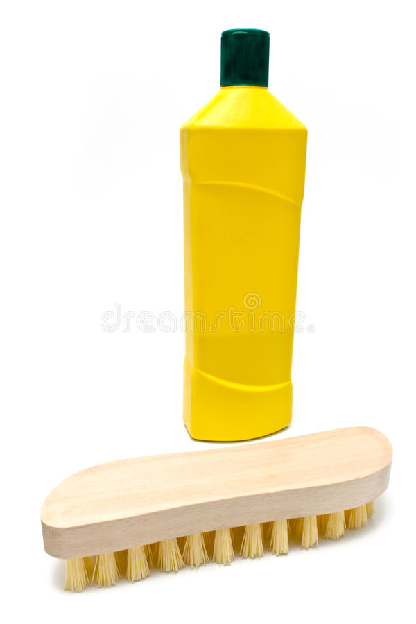 Wooden scrub brush with bottle of cleaning liquid stock photography