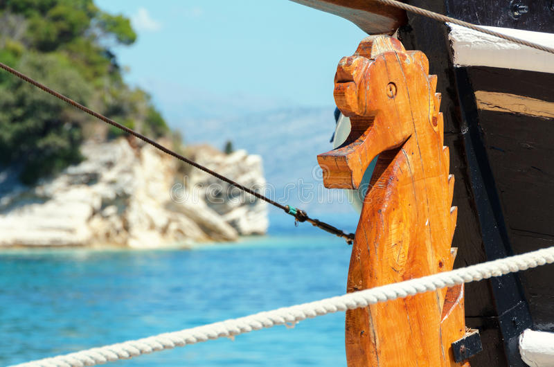 Wooden seahorse front of the ship stock photo