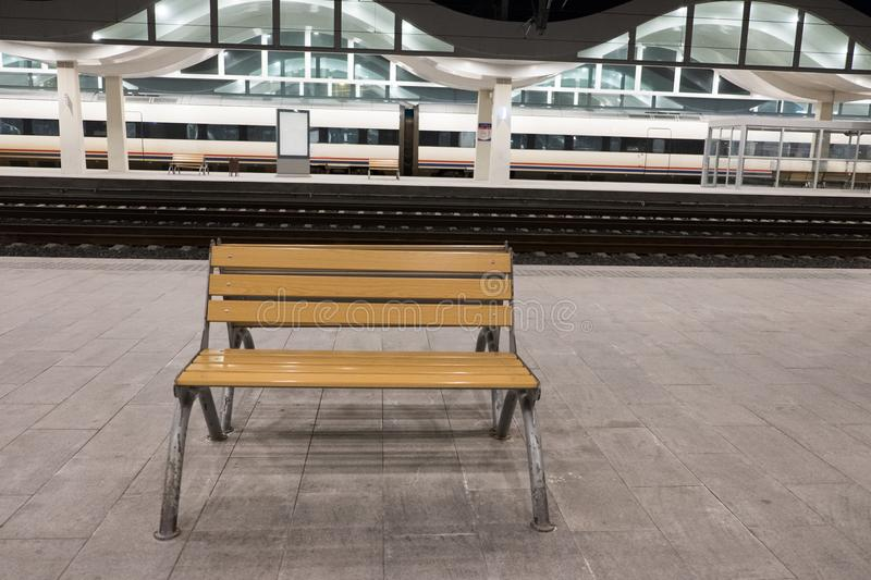 Wooden seat at the train station royalty free stock photos