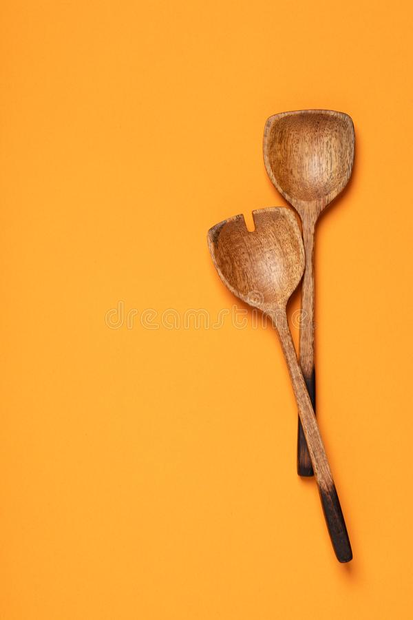 Colorful Spoons: Wooden Serving Spoons On Colorful Background Stock Image