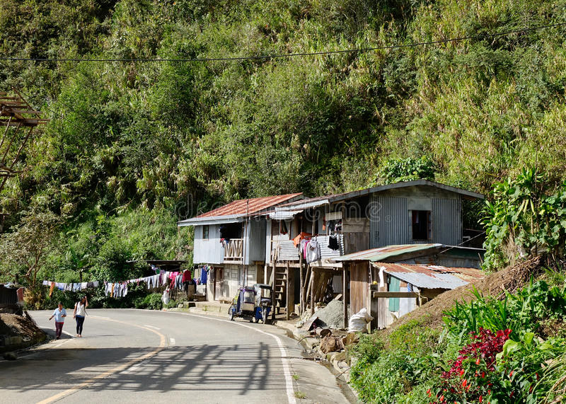 Wooden shacks on rural road in Banaue, Philippines royalty free stock images