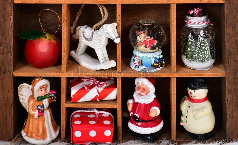 Wooden shadow box with christmas decor and toy collection royalty free stock photos