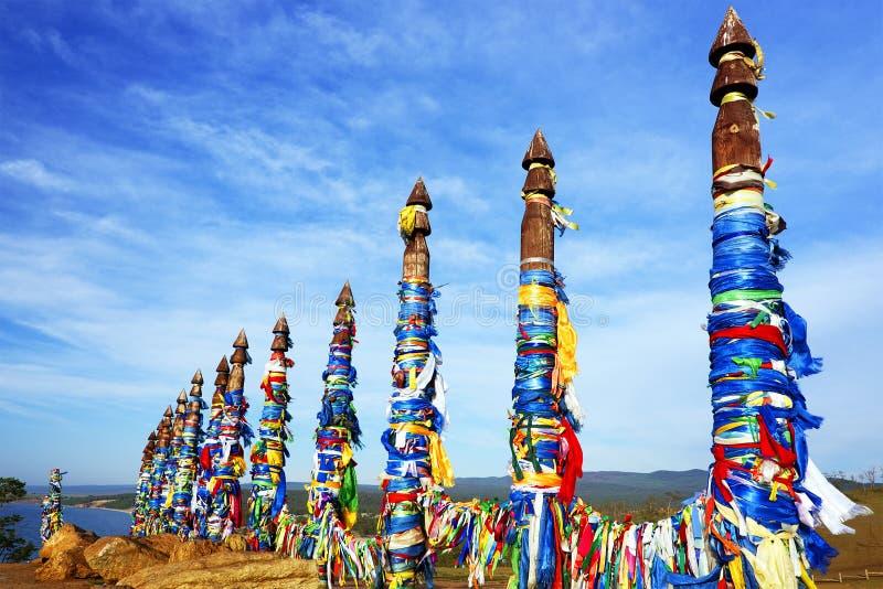 Wooden shaman totems at Burhan Cape, Baikal Lake stock photos