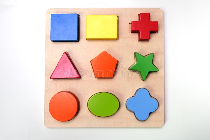 Puzzle with colored wooden figures royalty free stock photography