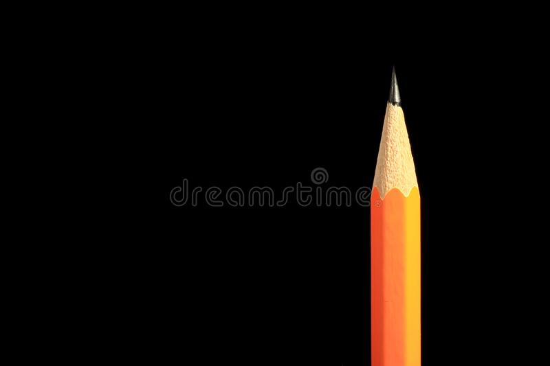 A wooden sharp pencil with an eraser. Isolated on black. royalty free stock photography