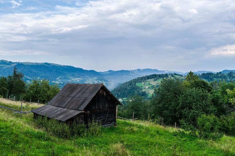 A wooden shed above a mountain valley royalty free stock photo
