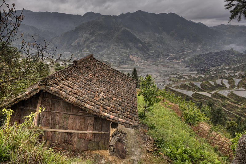 Wooden shed farmers in highlands of China, amid rice fields. Xijiang miao village, Guizhou Province, China - april 17, 2010: Living people Miao, Chinese ethnic royalty free stock photography