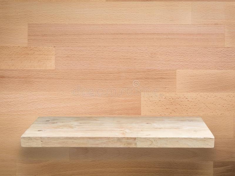 Wooden shelf. On wooden background royalty free stock image