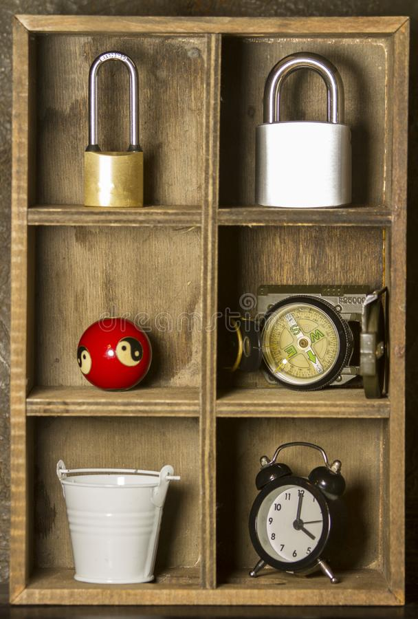 Wooden shelf and clock, lock, compass, bucket stock images