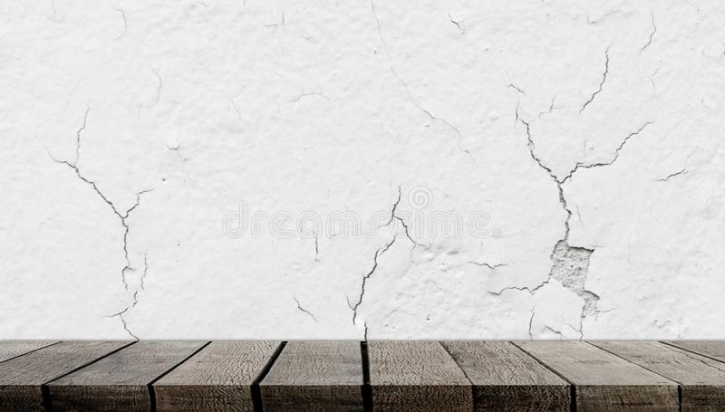 Wooden shelf on crack concrete wall for product display. Empty wooden shelf on crack concrete wall for product display stock photos