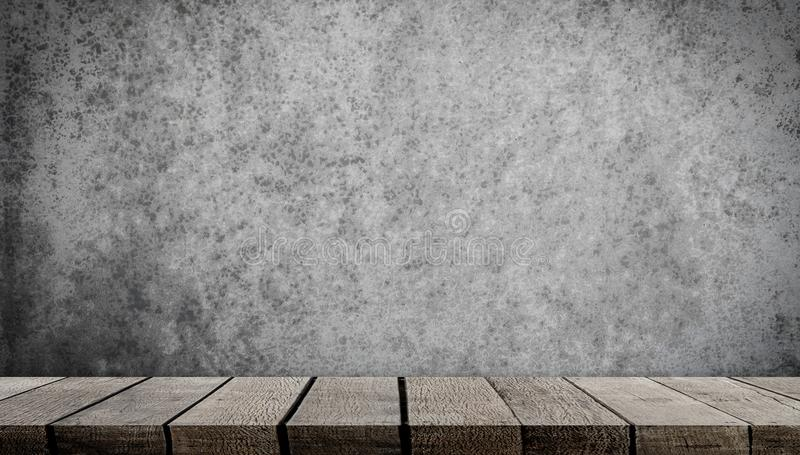 Wooden shelf on gray cement wall for product display royalty free stock photography