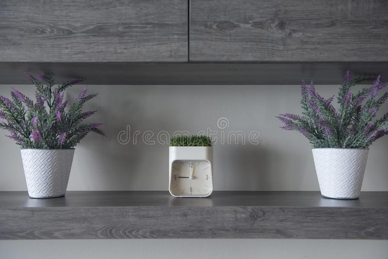 Download Wooden Shelf Interior With Flowers And Clock Stock Image - Image of accessories, decoration: 118721215